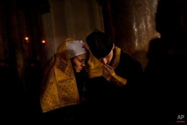 An Orthodox priest hears the confession of a nun inside the Church of the Nativity, traditionally believed by Christians to be the birthplace of Jesus Christ, during Orthodox Christmas celebrations in the West Bank city of Bethlehem, late Friday, Jan. 6, 2012. (AP Photo/Bernat Armangue)