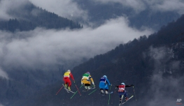 Switzerland's Fanny Smith, from left, Sweden's Anna Holmlund, Austria's Katrin Ofner and Canada's Kelsey Serwa compete during their ski cross race at the 2014 Winter Olympics, Friday, Feb. 21, 2014, in Krasnaya Polyana, Russia. (AP Photo/Matthias Schrader)