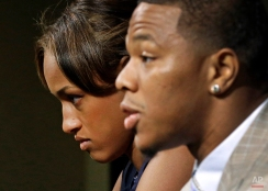 In this May 23, 2014, photo, Janay Rice, left, looks on as her husband, Baltimore Ravens running back Ray Rice, speaks during an NFL football news conference at the team's practice facility in Owings Mills, Md. Ray Rice spoke to the media for the first time since his arrest for assaulting his fiance, now his wife, at a casino in Atlantic City, N.J. (AP Photo/Patrick Semansky)