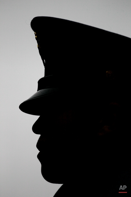 An Army cadet stands at attention before an NCAA college football game against Navy, Saturday, Dec. 8, 2012, in Philadelphia. (AP Photo/Matt Slocum)