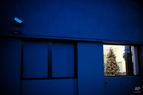 A Christmas tree stands in the lobby area of an apartment building early Monday, Dec. 8, 2014, in Los Angeles. (AP Photo/Jae C. Hong)