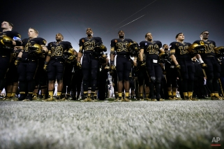 Members of the Army team stand for the singing of the school song after an NCAA college football game against Navy Saturday, Dec. 8, 2012, in Philadelphia. Navy won 17-13. (AP Photo/Matt Rourke)