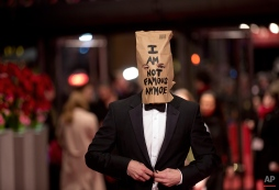 """Actor Shia LaBeouf poses for photographers, with a paper bag over his head that says """"I am not famous anymore"""" on the red carpet for the film """"Nymphomaniac"""" at the International Film Festival Berlinale in Berlin, Sunday, Feb. 9, 2014. (AP Photo/Axel Schmidt)"""