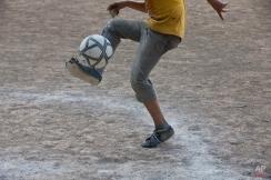 """In this Monday, Nov. 24, 2014 photo, Roberto Castellanos, plays soccer in a """"Goal for Life"""" project in a El Progreso neighborhood in Tegucigalpa, Honduras. (AP Photo/Esteban Felix)"""