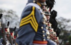 Philippine Military Academy cadets march during ceremonies on the 79th anniversary of the Armed Forces of the Philippines (AFP) at Camp Aguinaldo military headquarters in suburban Quezon city, north of Manila, Philippines on Thursday, Dec. 18, 2014. (AP Photo/Aaron Favila)
