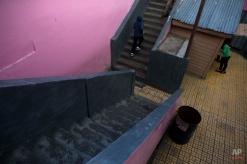 In this Thursday, Nov. 27, 2014 photo, Roberto Castellanos, walks up the stairs at his school in Tegucigalpa, Honduras. (AP Photo/Esteban Felix)