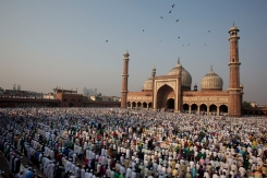 Indian Muslims offer prayers to mark the festival of Eid al-Adha at Jama Masjid in New Delhi, India, Monday, Oct. 6, 2014. (AP Photo/Bernat Armangue)