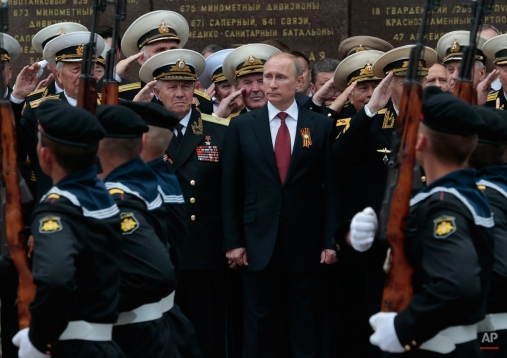 Russian President Vladimir Putin attends a parade marking the Victory Day in Sevastopol, Crimea, Friday, May 9, 2014. Putin extolled the return of Crimea to Russia before tens of thousands during his first trip to Black Sea peninsula since its annexation. The triumphant visit was quickly condemned by Ukraine and NATO. (AP Photo / Ivan Sekretarev)