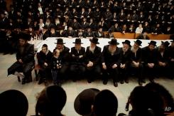 Ultra Orthodox Jewish men sit during a celebration of the Jewish holiday of Hanukkah in Bnei Brak, near Tel Aviv, Israel, Monday, Dec. 10, 2012. (AP Photo/Dan Balilty)