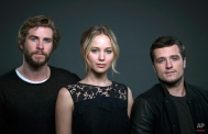 """Cast members in """"The Hunger Games: Mockingjay - Part 1"""" from left, Liam Hemsworth, Jennifer Lawrence and Josh Hutcherson, pose for a portrait in New York, Saturday, Nov. 15, 2014. (Photo by Drew Gurian/Invision/AP)"""