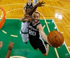 San Antonio Spurs' Manu Ginobili (20) drives to the basket past Boston Celtics' Brandon Bass during the second half of San Antonio's 111-89 win in an NBA basketball game in Boston, Sunday, Nov. 30, 2014. (AP Photo/Winslow Townson)