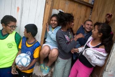"In this Thursday, Nov. 27, 2014 photo, Roberto Castellanos, jokes with friends from the ""Goal for Life"" soccer project at a El Progreso neighborhood in Tegucigalpa, Honduras. (AP Photo/Esteban Felix)"