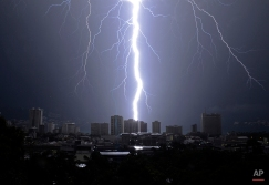 A bolt of lightning strikes down over the Pacific resort city of Acapulco, Mexico, during a thunderstorm on Monday, Oct. 7, 2013. (AP Photo/Bernandino Hernandez)