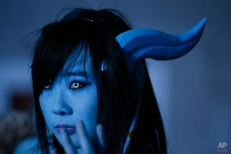 A woman, dressed as a game character called Draenei, attends the BlizzCon, the fan-centric celebration of video game publisher Blizzard, Friday, Nov. 7, 2014, in Anaheim, Calif. The annual convention kicked off Friday with more than 25,000 attendees. (AP Photo/Jae C. Hong)