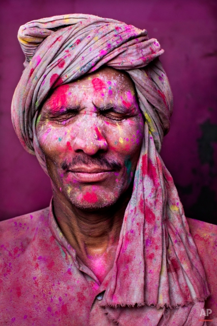 Bachhu Singh, an Indian Hindu man from Baumchalla, poses for a portrait during Lathmar Holy festival, in Barsana 115 kilometers ( 71 miles) from New Delhi, India, Sunday, March 9, 2014. The colorful holiday, celebrated mainly in India and Nepal, marks the beginning of spring and the triumph of good over evil. (AP Photo/Bernat Armangue)
