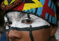 In this Oct. 19, 2014 photo, a young dancer from San Miguel de Allende, Guanajuato state, wears traditional face paint as he performs outside the Basilica of Guadalupe in Mexico City. The young man is part of a group of dancers that perform at the Basilica as a form of payment for a promise made to the Virgin of Guadalupe for a perceived miracle. (AP Photo/Marco Ugarte)