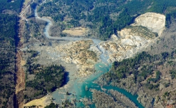 The massive mudslide that killed at least eight people and left dozens missing is shown in this aerial photo, Monday, March 24, 2014, near Arlington, Wash. The search for survivors grew, raising fears that the death toll could climb far beyond the eight confirmed fatalities. (AP Photo/Ted S. Warren)