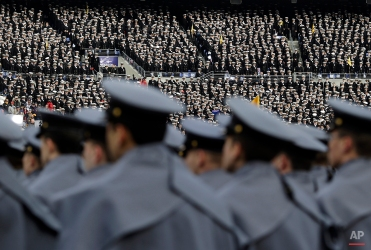 Navy Midshipmen, top, watch from the stands as Army Cadets stand in formation on the field before the Army-Navy NCAA college football game, Saturday, Dec. 13, 2014, in Baltimore. (AP Photo/Patrick Semansky)