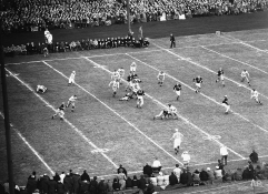 In this play between Army and Navy players in Philadelphia, Nov. 29, 1947, the following players can be seen: Elwyn Rowand (33); Arnold Galiffa (16); Randlett Lawrence (56); Amos Gillette (27); Goble Bryant (73); Joe Steffy (61); Ken Schweik (72); Dick Shimshak; Charlie Strahley (71); Dick Scott (57); Art Markel (83); and Myron Gerber (32). (AP Photo/Murray Becker)