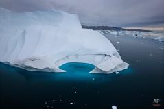 In this July 19, 2007 photo, an iceberg melts off the coast of Ammasalik, Greenland. (AP Photo/John McConnico)