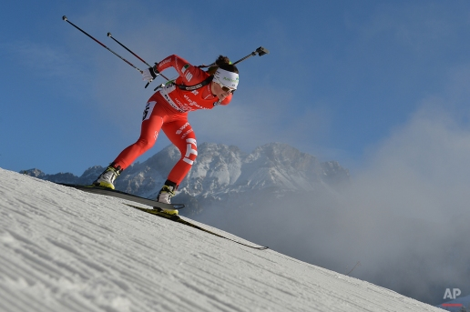 Italy's second placed Karin Oberhofer skis during the women's 7.5 km sprint biathlon World Cup competition, in Hochfilzen, Austria, on Friday, Dec. 12, 2014. (AP Photo/Kerstin Joensson)