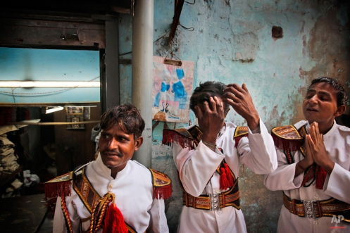 In this Nov. 28, 2014 photo, members of Master Band prepare for work, in New Delhi, India. (AP Photo/Manish Swarup)