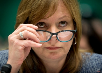 General Motors CEO Mary Barra lowers her eyeglasses as she testifies on Capitol Hill in Washington, Tuesday, April 1, 2014, before the House Energy and Commerce subcommittee on Oversight and Investigation. The committee is looking for answers from Barra about safety defects and mishandled recall of 2.6 million small cars with a faulty ignition switch that's been linked to 13 deaths and dozen of crashes. (AP Photo/Evan Vucci)