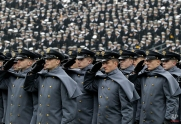 Army cadets salute as they march on the field before an NCAA college football game against Navy, Saturday, Dec. 8, 2012, in Philadelphia. (AP Photo/Matt Slocum)
