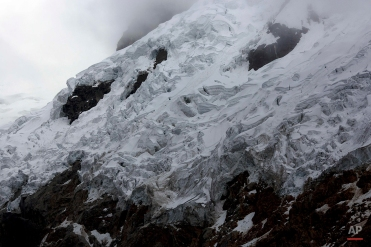 The Contrayerba glacier is seen in the Huascaran National Park in Huaraz, Peru, Wednesday, Dec. 3, 2014. Peru's glaciers have lost more one-fifth of their mass in just three decades, and the 70 percent of Peru's 30 million people who inhabit the country's Pacific coastal desert, depend on glacial runoff for hydropower and to irrigate crops, meaning their electricity and long-term food security could also be in peril. Higher alpine temperatures are killing off plant and animal species in cloud forests and scientists predict Pacific fisheries will suffer. (AP Photo/Rodrigo Abd)