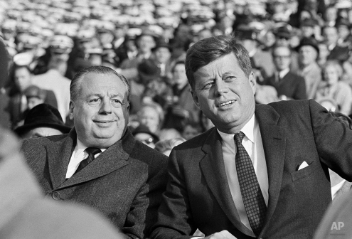 President John F. Kennedy is seated with Ohio Governor Michael DiSalle as they watch action from the Navy side of the field December 2, 1961 as Army and Navy battle it out on the gridiron at Philadelphia Stadium December 2, 1961 prior to the start of the Army-Navy game. Kennedy's attendance at this game marked the first time in nine years that a president has witnessed the Army-Navy football game. (AP Photo)