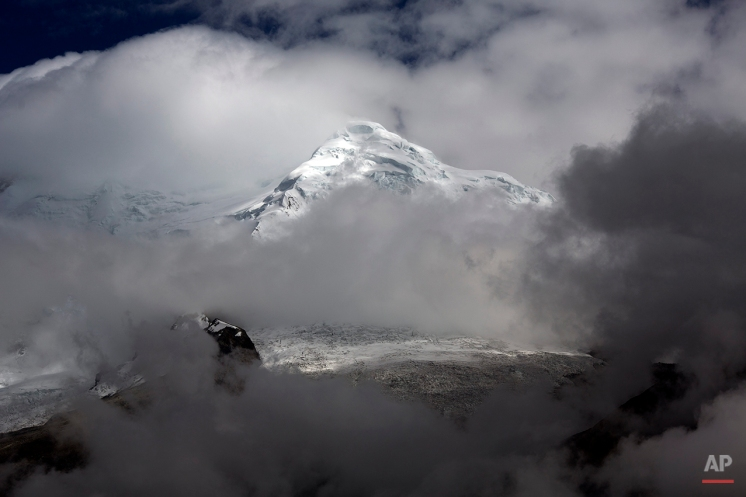 The glacier Huascaran is seen in Huaraz, Peru, Wednesday, Dec. 3, 2014. Peru's glaciers have lost more one-fifth of their mass in just three decades, and the 70 percent of Peru's 30 million people who inhabit the country's Pacific coastal desert, depend on glacial runoff. Higher alpine temperatures are killing off plant and animal species in cloud forests. (AP Photo/Rodrigo Abd)