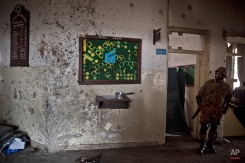 A wall riddled with bullet marks, inside the Army Public School attacked last Tuesday by Taliban gunmen, in Peshawar, Pakistan, Thursday, Dec. 18, 2014. (AP Photo/Muhammed Muheisen)