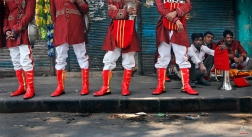 In this Nov. 3, 2014 photo, members of Master Band wait for transportation to leave for work, in New Delhi, India. (AP Photo/Manish Swarup)