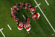Atlanta Falcons quarterback Matt Ryan (2) calls a play against the Carolina Panthers in the huddle during the second half of an NFL football game, Sunday, Dec. 28, 2014, in Atlanta. (AP Photo/John Bazemore)
