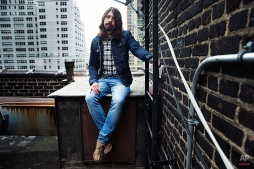 """Rock musician and creator of the new HBO series """"Foo Fighters Sonic Highway"""" Dave Grohl poses for a portrait, on Wednesday, Oct. 15, 2014 in New York. (Photo by Victoria Will/Invision/AP)"""