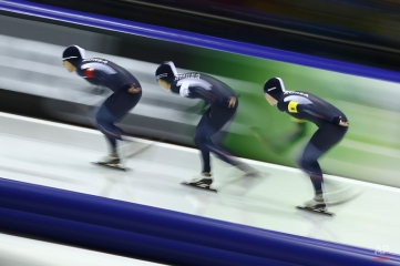 Team Korea with Bo-Reum Kim, left, Ye-Jin Jun, center, and Seon-Yeong Noh, right, competes in the women's team pursuit race of the World Cup Speed Skating at Thialf skating rink in Heerenveen, northern Netherlands, Saturday, Dec. 13, 2014. (AP Photo/Peter Dejong)