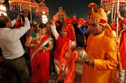 In this Nov. 3, 2014 photo, members of Indian Brass band, play as they accompany a wedding procession, in New Delhi, India. (AP Photo/Manish Swarup)