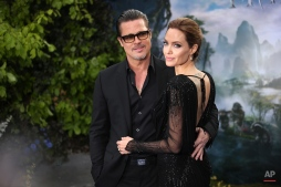 """Actors Brad Pitt and Angelina Jolie arrive for the """"Maleficent"""" exhibit in Kensington Gardens, in London, Thursday, May 8, 2014. (Joel Ryan/Invision/AP)"""