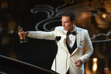 """Matthew McConaughey accepts the award for best actor in a leading role for """"Dallas Buyers Club"""" on stage during the Oscars at the Dolby Theatre on Sunday, March 2, 2014, in Los Angeles. (Photo by John Shearer/Invision/AP)"""