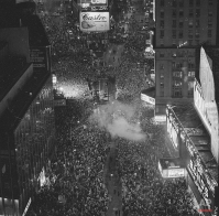 As a smoke bomb goes off at center, revelers welcome 1977 at New York's Times Square Friday night. (AP Photo/Suzanne Vlamis)