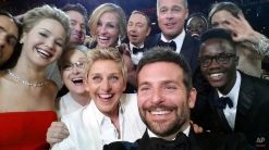 """This image released by Ellen DeGeneres shows actors, front row from left, Jared Leto, Jennifer Lawrence, Meryl Streep, Ellen DeGeneres, Bradley Cooper, Peter Nyong'o Jr. and, second row, from left, Channing Tatum, Julia Roberts, Kevin Spacey, Brad Pitt, Lupita Nyong'o and Angelina Jolie as they pose for a """"selfie"""" portrait on a cell phone during the Oscars at the Dolby Theatre on Sunday, March 2, 2014, in Los Angeles. (AP Photo/Ellen DeGeneres)"""