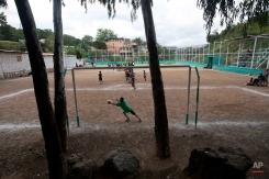 """In this Monday, Nov. 24, 2014 photo, Roberto Castellanos stops a soccer ball during a practice at a """"Goal for Life"""" project at El Progreso neighborhood in Tegucigalpa, Honduras. (AP Photo/Esteban Felix)"""