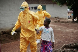 Nine-year-old Nowa Paye is taken to an ambulance after showing signs of the Ebola infection in the village of Freeman Reserve, about 30 miles north of Monrovia, Liberia,Tuesday Sept. 30, 2014. (AP Photo/Jerome Delay)