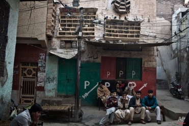 Relatives and mourners of Pakistani student Nasrullah Abdullah, 17, who was killed in Tuesday's Taliban attack on a military-run school, chant prayers while gathering outside his home, in Peshawar, Pakistan, Thursday, Dec. 18, 2014. (AP Photo/Muhammed Muheisen)