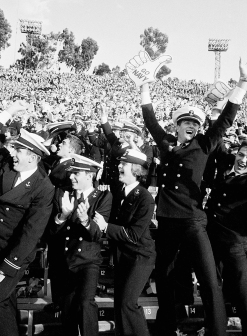 Happy Midshipmen exult in yet another Navy score during late stages of the Army-Navy game, Friday, Nov. 25, 1983 in the Rose Bowl in Pasadena; CA. Navy bombed Army, 42-13. (AP Photo/Reed Saxon)