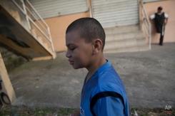 In this Tuesday, Nov. 25, 2014 photo, Roberto Castellanos, walks to work, in Tegucigalpa, Honduras. (AP Photo/Esteban Felix)