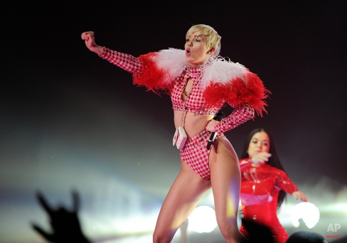 Singer Miley Cyrus performs at the Barclays Center in New York, Saturday, April 5, 2014. (Photo by Evan Agostini/Invision/AP)