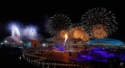 Fireworks are seen over the Olympic Park during the opening ceremony of the 2014 Winter Olympics in Sochi, Russia, Friday, Feb. 7, 2014. (AP Photo/Julio Cortez)
