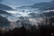 Morning fog engulfs a village outside Izbasesti, Romania, Tuesday, Dec. 16, 2014. Severe fog affected large areas of Romania causing traffic disruptions. (AP Photo/Vadim Ghirda)