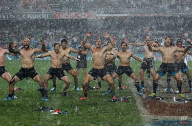 The New Zealand rugby team dance after winning the Hong Kong Sevens rugby tournament against England in Hong Kong, Sunday, March 30, 2014. (AP Photo/Kin Cheung)